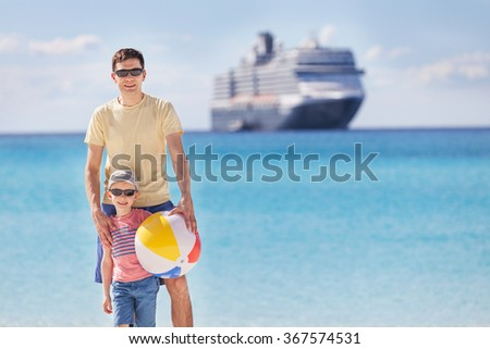 family of two enjoying summer at the beach, vacation and cruise concept - stock photo