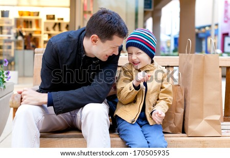 family of two having fun during shopping - stock photo
