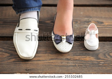 family of white shoes waiting for baby - stock photo