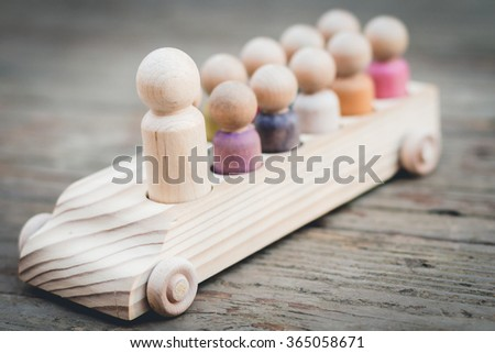 Family of Wooden Peg People in Car - stock photo