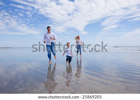 Family on a beach heaving fun. - stock photo