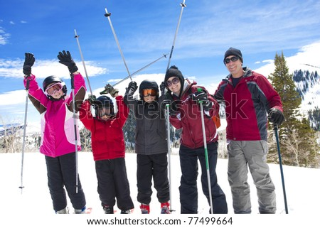 Family on a Fun Ski Vacation - stock photo