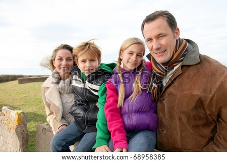 Family on a walk day in the countryside