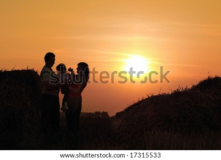 family on background sunset
