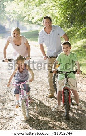Family on bicycle ride - stock photo