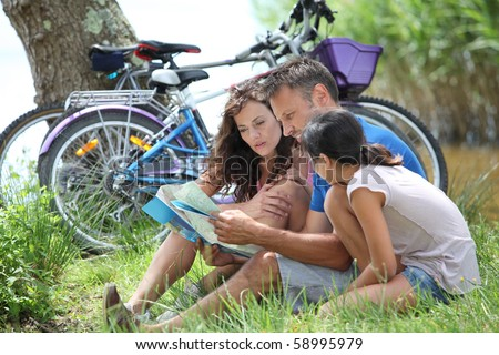 Family on bicycle ride in the countryside - stock photo