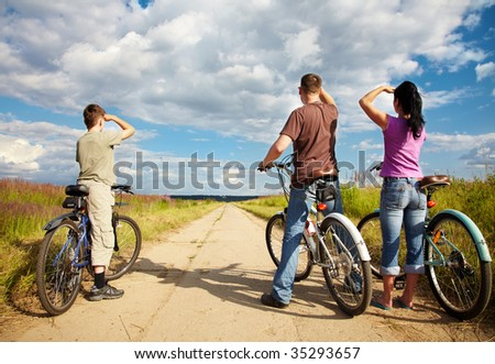 Family on bicycle ride through woodland - stock photo