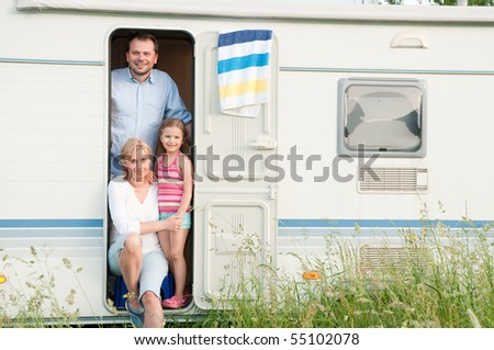 Family on camper - stock photo