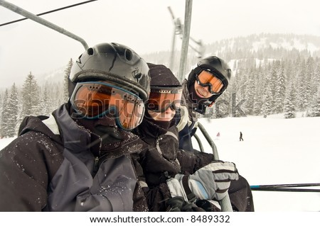 Family on Chairlift ready to ski and snowboard - see more in portfolio - stock photo