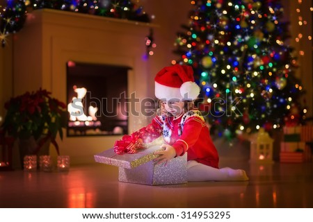 Christmas family reading book father child stock photo for Best warm places to live with a family