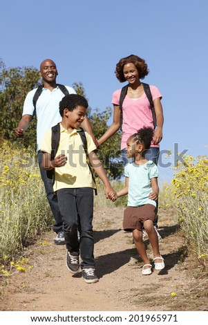 Family on country hike - stock photo