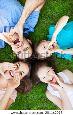 Family on grass shouting - stock photo
