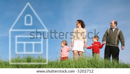 family on grass with house of dream - stock photo