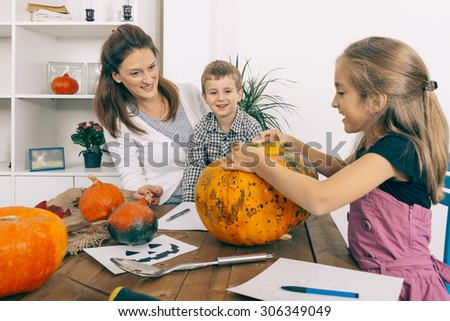 Family on Halloween night. Selective focus and small depth of field. - stock photo