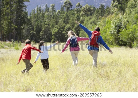 Family On Hike In Beautiful Countryside - stock photo