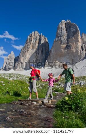 "Family on mountain hike - Tre Cime di Lavaredo "" Drei Zinnen "" - Dolomite - Italy - stock photo"