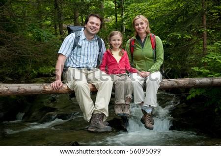 Family on mountain trek - stock photo