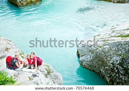 Family on mountain trek - stock photo