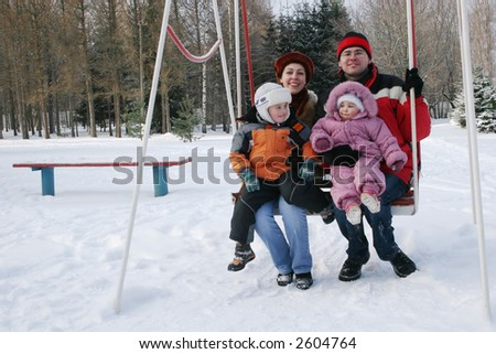 family on seesaw - stock photo