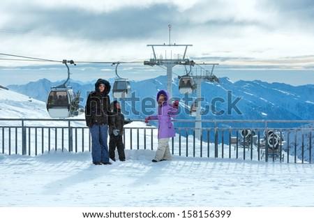 Family on ski station top and morning winter mountain landscape. Ski resort Molltaler Gletscher, Carinthia, Austria. - stock photo
