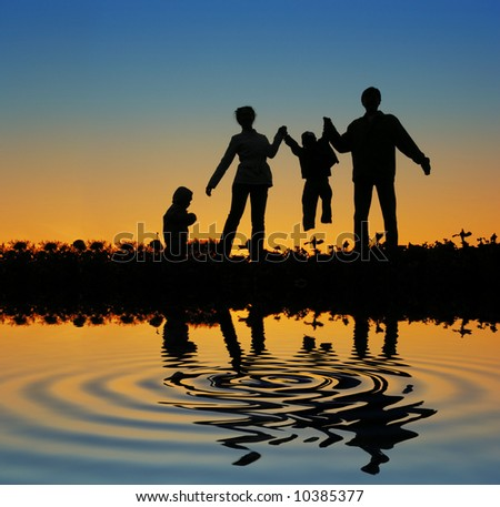 family on sunset pond - stock photo