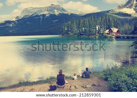 Family on the bank of Emerald lake (Yoho National park. Alberta. Canada) Image done with a vintage retro instagram filter   - stock photo