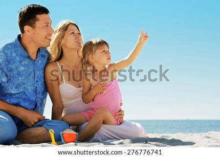 family on the beach - stock photo
