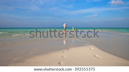 Family on the beach of Maldive Island  - stock photo