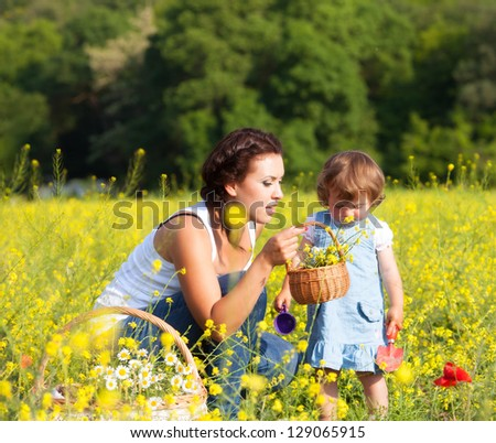 Family on the meadow - stock photo
