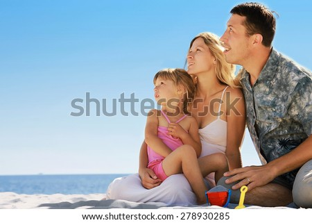 family on the shore of the sea