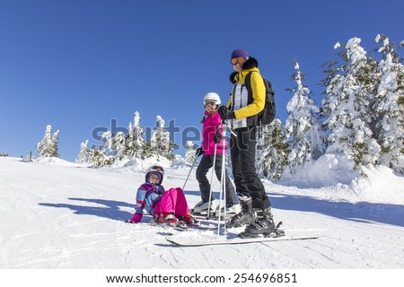 Family on the ski slope - stock photo