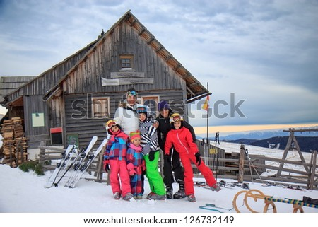 Family on the ski vacation - stock photo