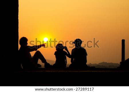 family on the sunset 3 - stock photo