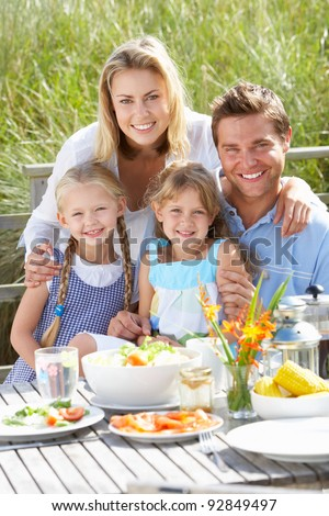 Family on vacation eating outdoors - stock photo
