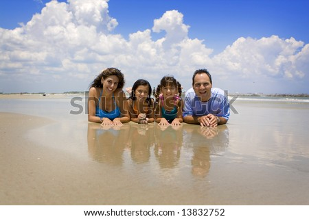 Family on vacation having fun in the sun - stock photo