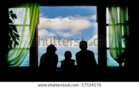 family on vacation, silhouettes on sky background - stock photo