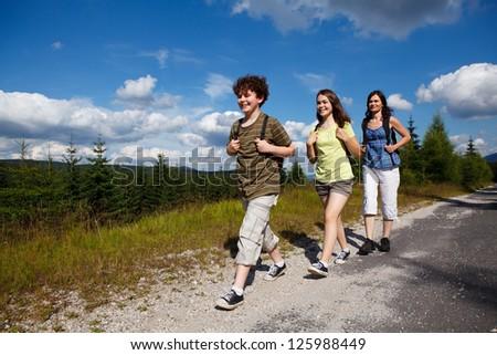 Family on walking tour - stock photo