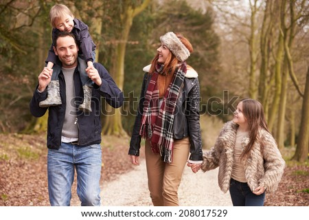 Family On Winter Countryside Walk Together - stock photo