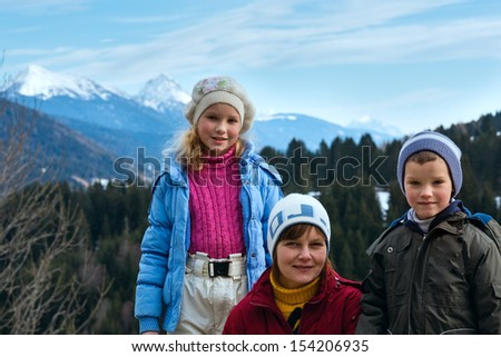 Family on winter mountain background.  View from Obergail village outskirts in Lesachtal (Austria).