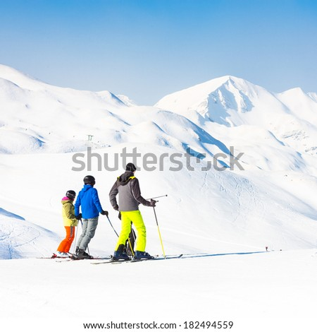 Family on winter ski vacations in ski slopes in Alps, Vogel, Slovenia, Europe.