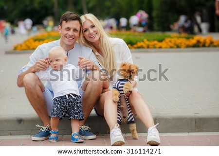 Family outdoors. family of three having fun and playing outdoors. happy family concept.