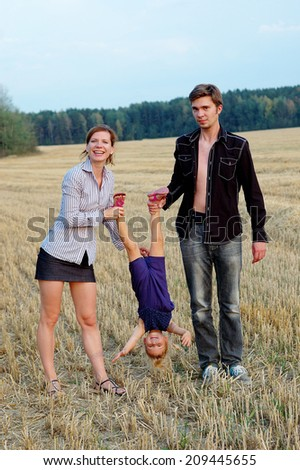 family outdoors in field