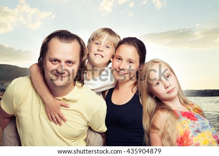 Family Outdoors. Kids with Mother and Father - stock photo