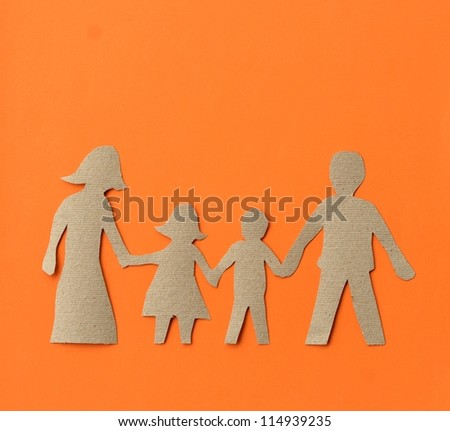 Family paper cut-out - stock photo