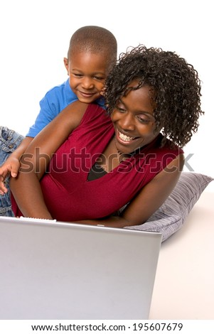 Family: Parent And Child Sitting And Using Laptop Computer
