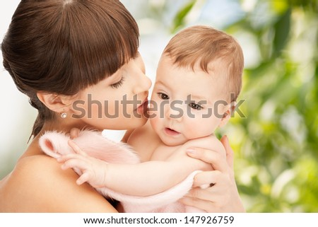 family, parenting and child care concept - happy mother with adorable baby