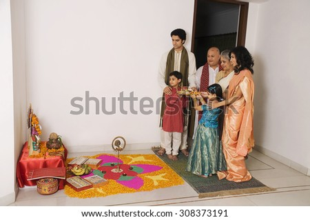 Family performing a pooja - stock photo