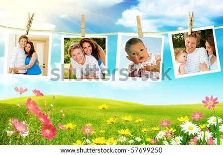Family photos hanging over spring flowers - stock photo