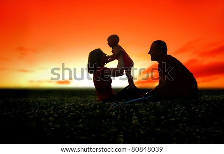 Family picnic at sunset - stock photo