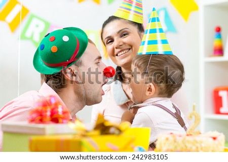 family play celebrating child birthday at home - stock photo